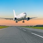 Airplane taking off from runway signifies the lifestyle in retirement that can be achieved with financial planning for retirement
